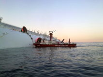 Sinking cruise ship Costa Concordia royalty free stock photography