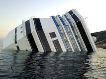 Sinking cruise ship Costa Concordia stock images