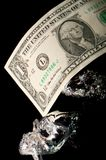 The Sinking Dollar Royalty Free Stock Photos