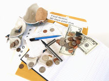 Sinking in the Economy. US Currency and broken ceramic pieces from a bank lay over empty ledger books and past due notices Royalty Free Stock Image