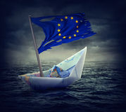 Sinking euro ship with a torn flag. Crisis concept Royalty Free Stock Images