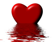 Sinking heart. Heart shape sinking in water or rising from the ocean Royalty Free Stock Image