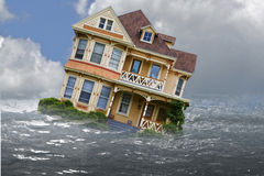 Sinking House foreclosure. House depicted in a flood with water and reflection stock photos