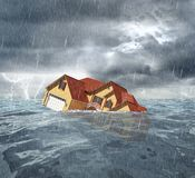 Sinking house in the sea Royalty Free Stock Photo