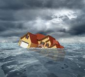 Sinking house in the sea Royalty Free Stock Photography