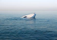 Sinking modern large white boat goes underwater stock photo