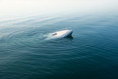 Sinking modern large white boat goes underwater royalty free stock photography