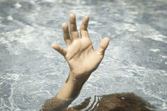 Sinking person calls for help. Royalty Free Stock Photography