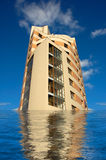 Sinking skyscraper. The sinking skyscraper - global warming or bankruptcy Royalty Free Stock Image