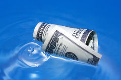 Sinking USA Currency Royalty Free Stock Image