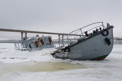 Sinking vessel in a frozen river Stock Photo