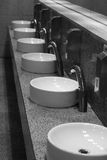 Sinks. Luxury sinks in a public toilet. shot in black and white royalty free stock photography