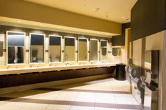 Sinks and hand dryers in public restroom. Rows of sinks and hand dryers in a luxury public restroom Royalty Free Stock Images