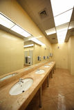 Sinks and mirrors in public restrooms Royalty Free Stock Photography