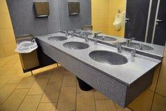 Sinks. In a public restorom stock images