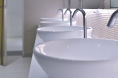 Sinks. In the toilet stock photos