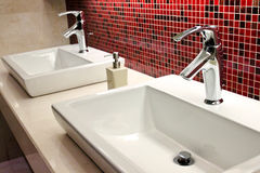 Sinks and taps Stock Image