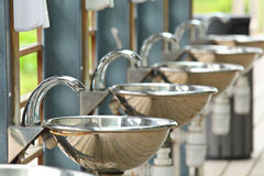 Sinks and taps outdoor Royalty Free Stock Image