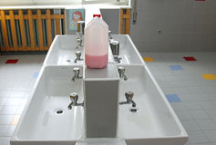 Sinks and washbasins with very low taps in the toilets of a nurs Stock Images