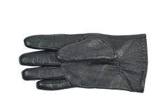 Sinlge black leather glove isolated. Over the white background Royalty Free Stock Photography