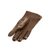Sinlge brown leather glove isolated. Over the white background Royalty Free Stock Photography