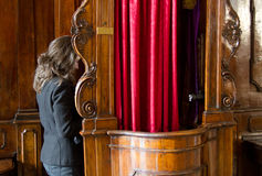 Sinner in confession booth. Sinner woman confess in confession booth in church Stock Images