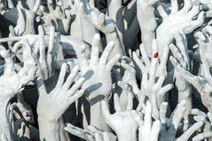 The sinner's hands. In hell (with the artist's joke), Wat Rong Khun, Chiang Rai, Thailand Stock Photos