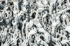 The sinner's hands. In hell, Wat Rong Khun, Chiang Rai, Thailand Royalty Free Stock Photography