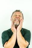 Sinnesrörelser - den nära övre ståenden av mannen smärtar in och sorg, studioskott arkivbilder
