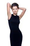 Sinnlichkeitfrau im schwarzen Kleid Stockbilder