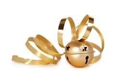 Sino de tinir dourado com fita ondulada Imagens de Stock Royalty Free