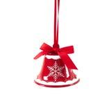 Sino de tinir vermelho do Natal isolado no ano novo do fundo branco Fotos de Stock Royalty Free