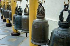 Sinos da fileira no templo Foto de Stock