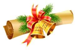 Sinos de Natal do ouro com o rolo vermelho da curva e do papel Fotografia de Stock