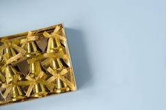 Sinos dourados em um fundo azul foto de stock royalty free