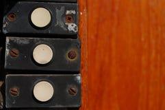 sinos em uma porta em uma fileira Foto de Stock Royalty Free