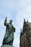 Sint BavoKerk church with Laurens Janszoon Coster statue Stock Image