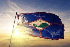 Sint Eustatius of Netherlands flag textile cloth fabric waving on the top sunrise mist fog. Beautiful royalty free stock photos