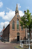 Sint Hippolytuskapel Delft con Nieuwe Kerk nel fondo Immagini Stock Libere da Diritti