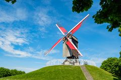Sint-Janshuis Mill, windmill with few cloud and blue sky backgro Stock Photography