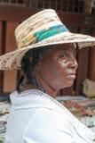 A Sint Maarten vendor poses with her wares. stock image