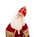 Sinterklaas смотря вверх на белой предпосылке Стоковые Фото
