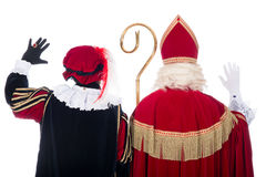 Sinterklaas and Black Pete from the back Royalty Free Stock Image