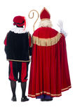 Sinterklaas and Black Pete from the back Royalty Free Stock Images