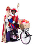 Sinterklaas and Black Pete on a bike Royalty Free Stock Photos