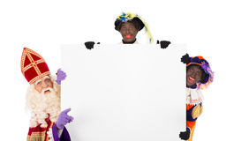 Sinterklaas and Black Pete with whiteboard Royalty Free Stock Photos