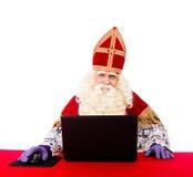 Sinterklaas com portátil Imagem de Stock Royalty Free