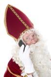 Sinterklaas com um telefone móvel imagem de stock royalty free