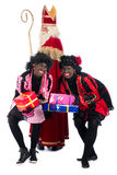 Sinterklaas and a couple of his helpers Royalty Free Stock Photos