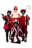 Sinterklaas and a couple of his helpers Stock Images
